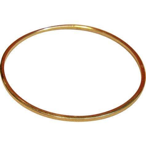 solid bangle bracelet in 14k yellow gold from