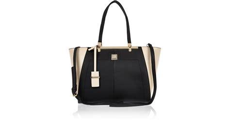 lyst river island black winged tote handbag in black