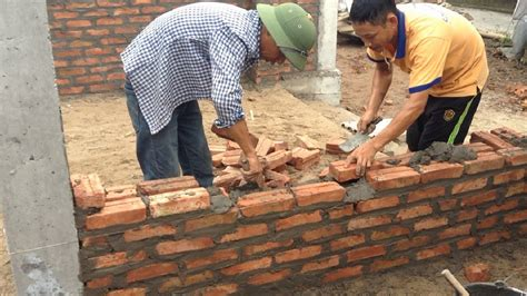 steps in building a house building house step by step build a wall using brick