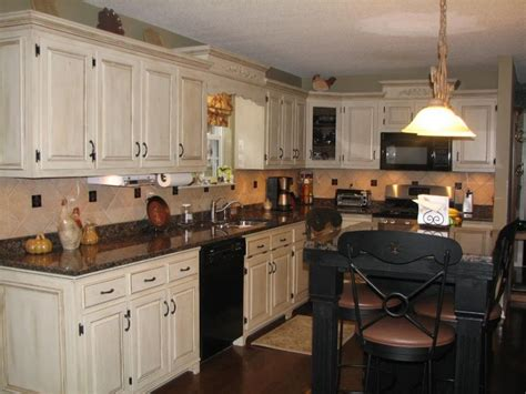 Shabby Chic Kitchen Idea With White Kitchen Cabinets And White Kitchen Cabinets With Black Appliances