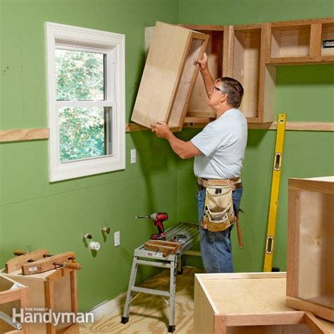 how to install upper kitchen cabinets install cabinets like a pro the family handyman