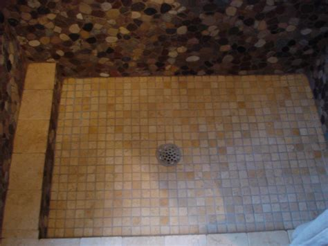 Riverstone shower walls with a 1x1 tumbled marble traditional mud pan shower floor new jersey