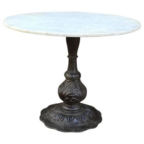 diogo cast iron base glass top accent table 24336 marble dining table with ornate cast iron base at 1stdibs