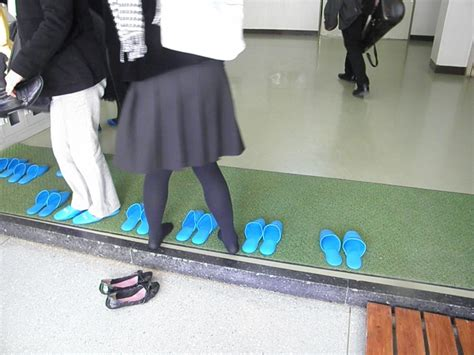 taking shoes off in house why do japanese students take off their shoes in school