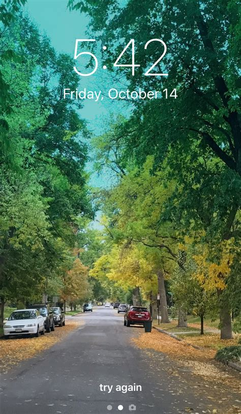 how do i change my iphone lock screen wallpaper ask
