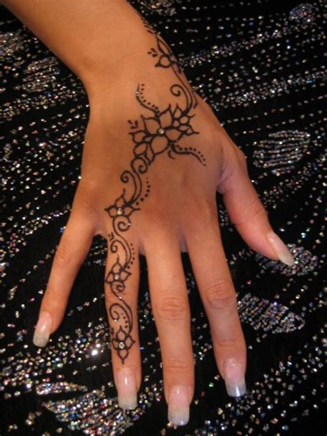 tattoo on finger and hand 60 hand tattoos for men and women amazing tattoo ideas