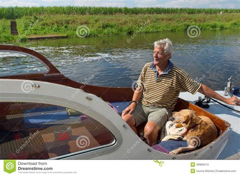 motor boat dog man and dog in boat stock photo image of baot motor