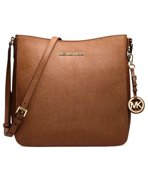 Mk Jetset Travel Bag michael kors michael jet set travel large saffiano messenger bag in brown fuschia silver lyst