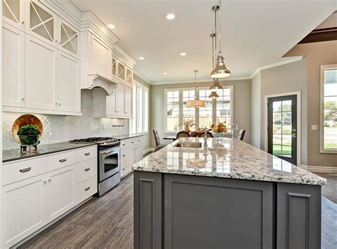Accent Color For White And Gray Kitchen by White Kitchen Cabinetry With Grey Accent Island Chrome