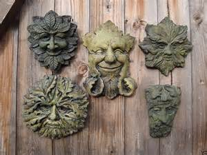 Various green man garden ornaments to hang around your yard