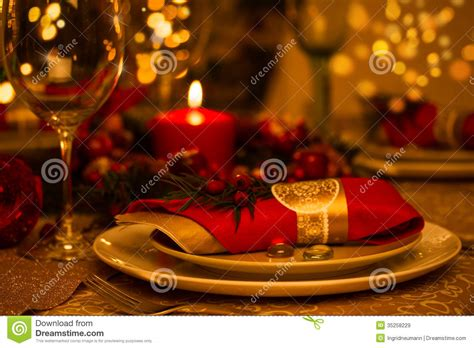Setting Christmas Table - christmas table setting with holiday decorations stock image image 35258229