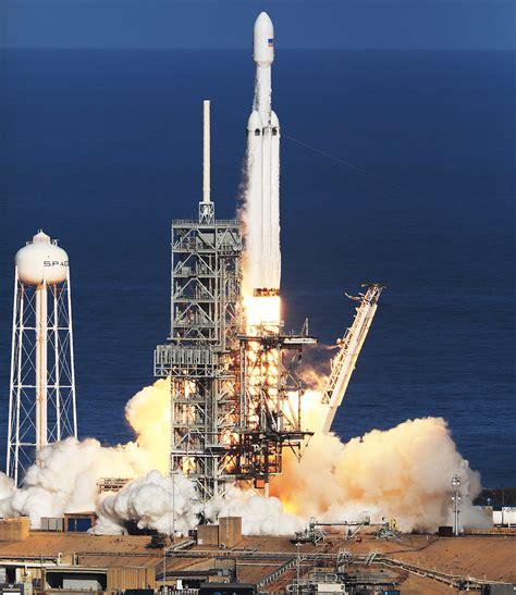 elon musk rocket launch elon musk launches tesla into orbit on spacex s falcon heavy