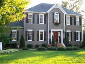 Door Accent Colors For Greenish Gray accenting this grey house with black dark shutters is a