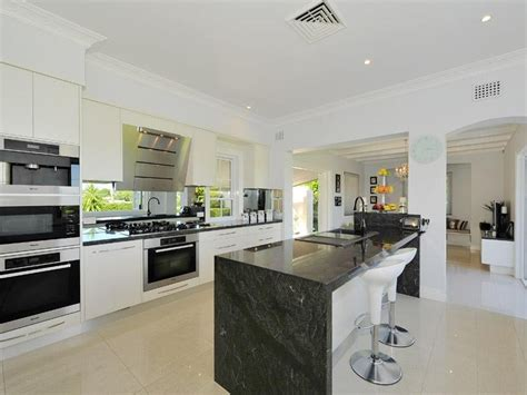 modern kitchen designs with island modern island kitchen design using granite kitchen photo