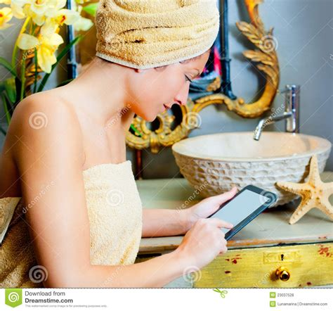 reading in bathroom female in bathroom reading ebook tablet royalty free stock photos image 23037528