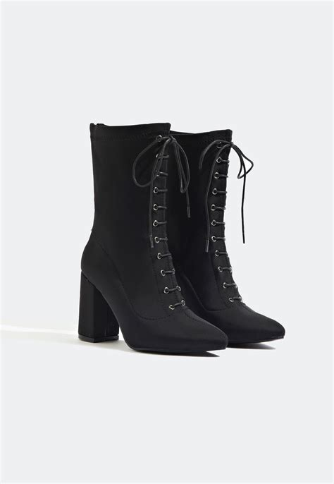 suki lace up front ankle boot black boots
