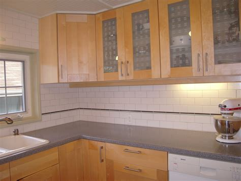 kitchen cabinet tiles kitchen with subway tile backsplash and oak cabinets