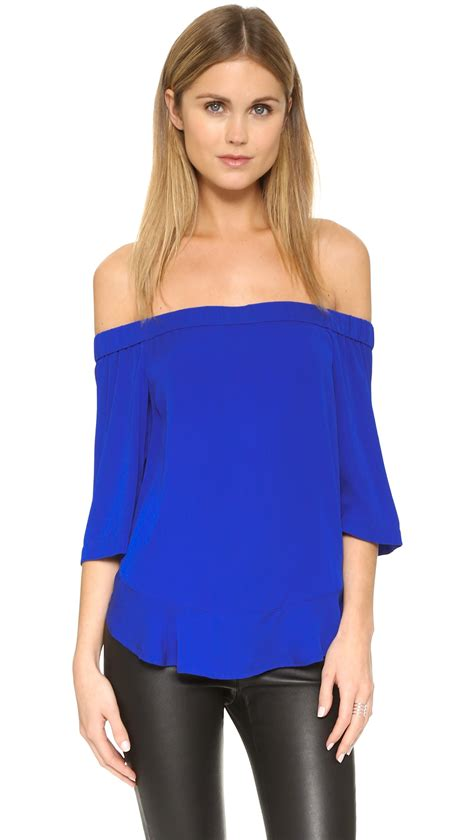 Blue Top shoulder top in blue lyst