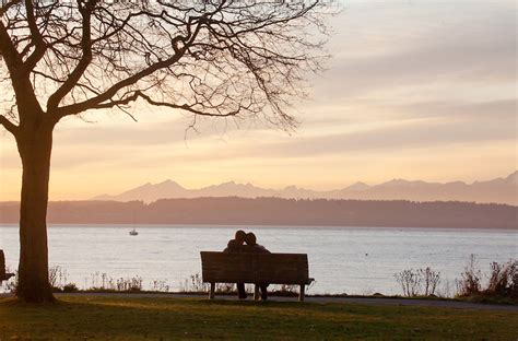 lovers on a park bench seattle golden gardens park couple on bench joel rogers photography northwest