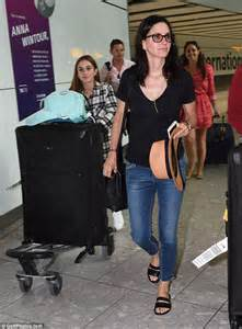 Courteney Cox Stuns With by Courteney Cox Stuns As She Lands At Heathrow Airport With