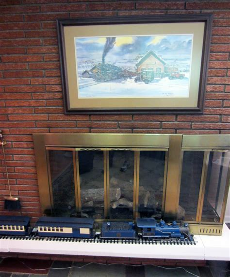 steam fireplace displaying model trains outside of your room o