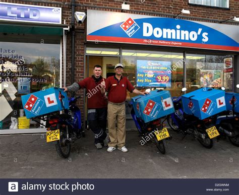 domino pizza online delivery delivery rider outside dominos pizza in sutton surrey