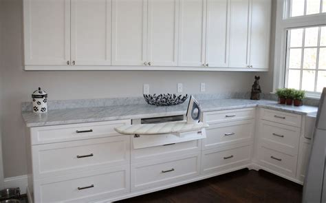 cabinet with ironing board top ironing board cabinet extensions for organized laundry rooms