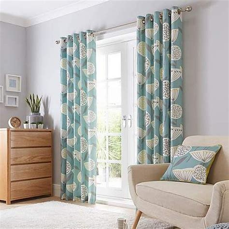 teal curtains and cushions emmott teal lined eyelet curtains dunelm home