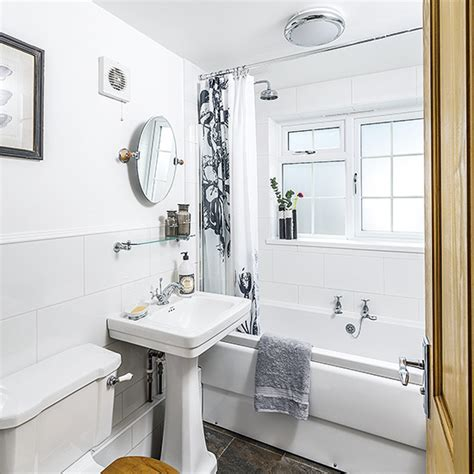 white bathroom with grey accessories ideal home