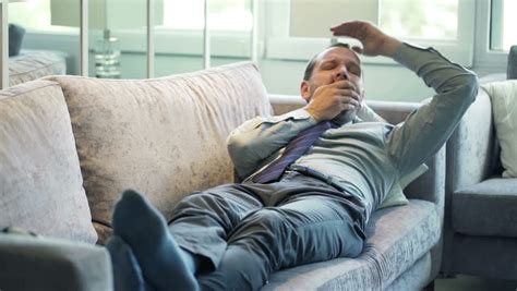 3 on a couch game businessman sleeping on the sofa stock footage video