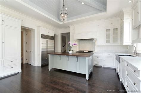 White On White Kitchen Ideas Kitchen Cabinets Traditional White 166 S49407037x2 Wood Island Blue Walls Subway Tile Jpg