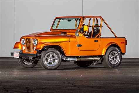 orange jeep cj this 8 second drag jeep follows the road less traveled