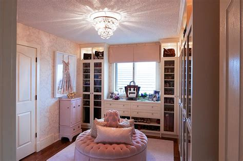 Pink Walk In Closet by Walk In Closet With Trellis Wallpaper Transitional Closet