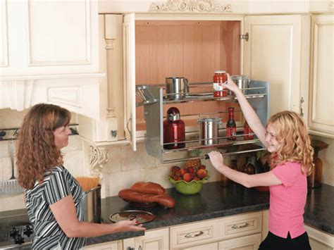 pull down kitchen cabinets shelves that slide wall cabinet pull down shelving system