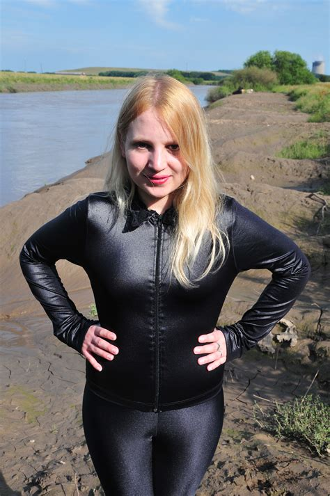 shiny spandex girl in mud the catsuit mud angel felicity takes to the mudbanks in