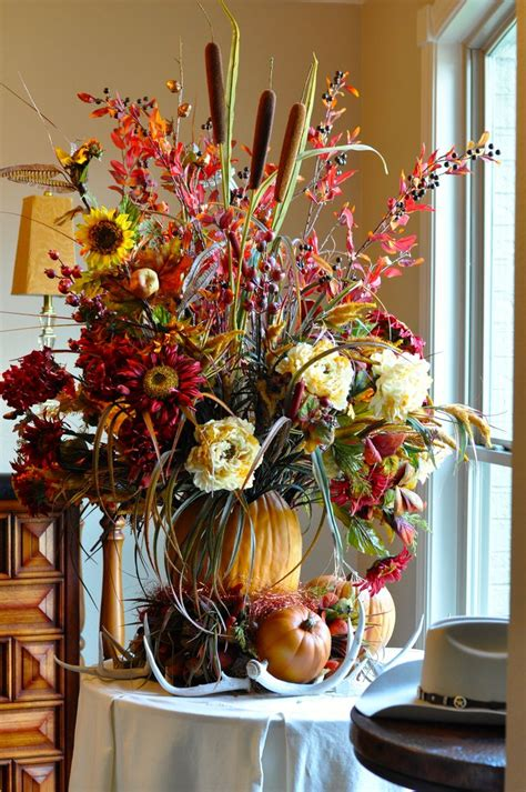 fall centerpieces with feathers fall floral arrangement floral centerpiece decor
