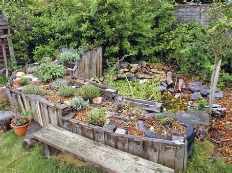 hugelkultur bed how to make a pond and hugelkultur with pallets