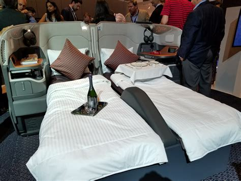 singapore airlines introduced  double beds  business
