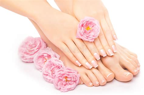 Jual Meni Pedi Cure by Pedicure And Manicure With A Pink Flower Stock Photo