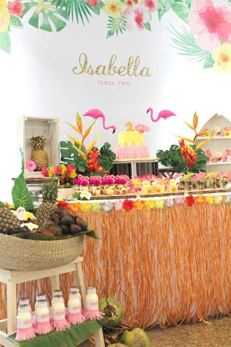 dessert table from a tropical hawaiian flamingo party via