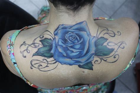 tattoos of blue roses blue cover up