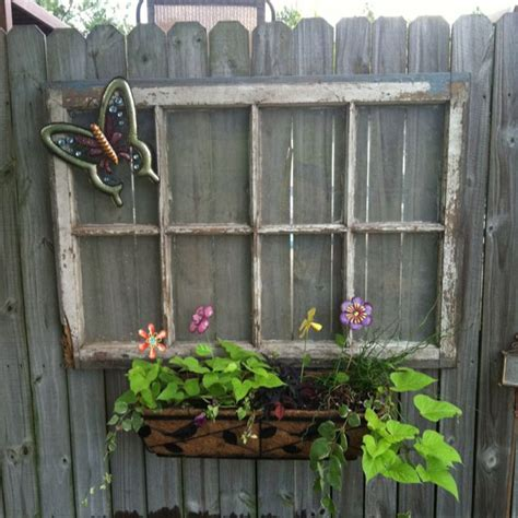 old window we hung on the privacy fence with a window box