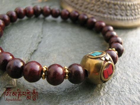 what is a guru bead rosewood bracelet mala with decorated guru bead purified