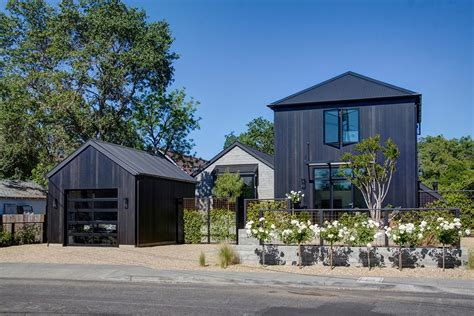 Contemporary Kitchen Carts And Islands black siding exterior farmhouse with glass garage door