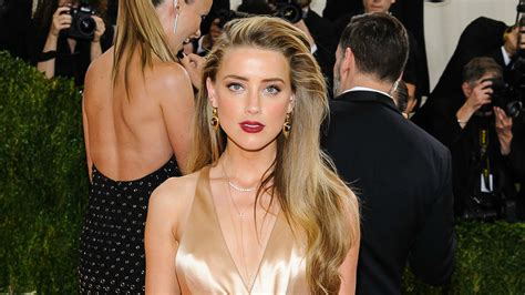 rumors amber heard going for big fish elon musk after amber heard s lawyer tries to set the record straight