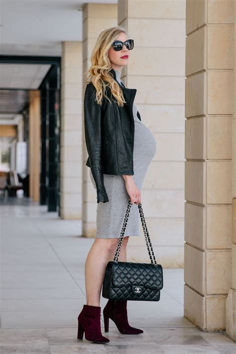 edgy maternity outfit leather jacket sweater dress