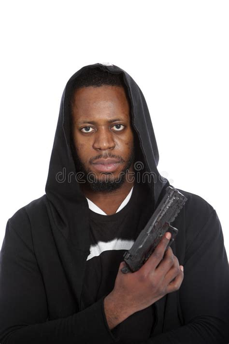 Black Gangster hooligan or gangster with a gun royalty free stock