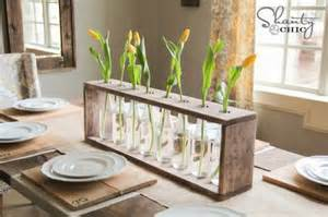 Bottles gain new life in this rustic centerpiece photo shanty2chic