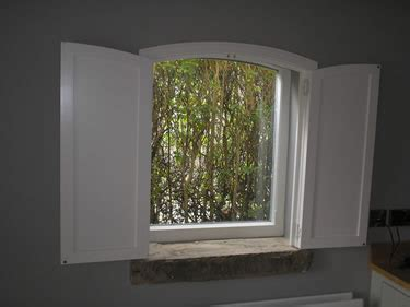 solid panel interior window shutters louvered or raised panel shutters which is best