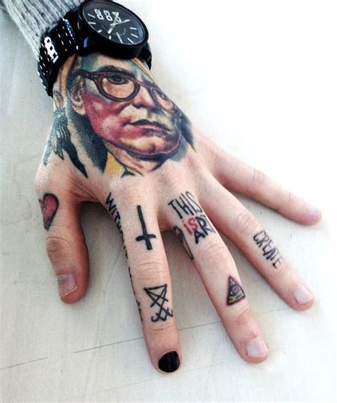 65 fierce and funky finger tattoos